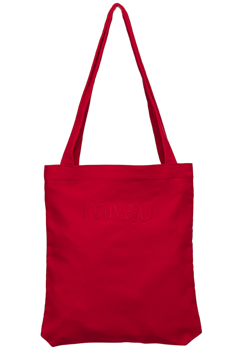 Red tote bag made out of certified organic moleskin with gives it a soft feel. Big enough to fit a computer or a few sketchbooks.